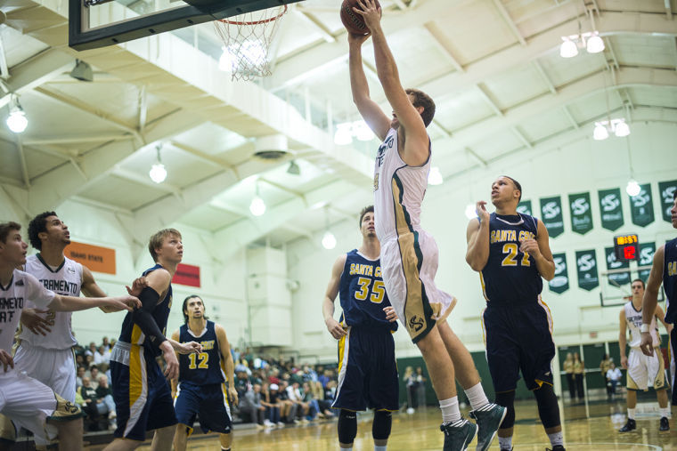 Junior forward No. 34 Alex Tiffin scores against the UC Santa Cruz Banana Slugs on Friday at the Nest.
