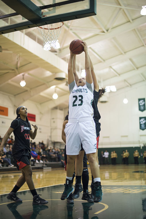 Freshman forward No. 23 Hallie Gennett shoots the ball against the Cal State Northridge Matadors.
