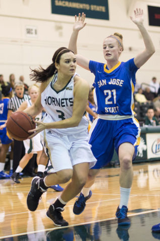 Freshman guard No. 3 Gigi Hascheff fights past the San Jose State Spartans at the game on Saturday in the Nest.