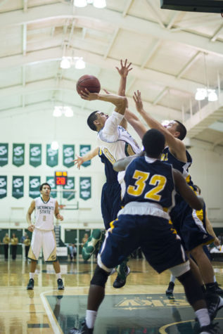 Junior guard No. 10 Mikh McKinney's shot is contested by the UC Santa Cruz Banana Slug defenders.