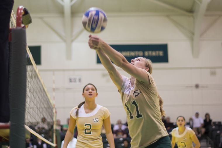 Sophomore outside hitter No. 11 Sloan Lovett plays against the Idaho State Bengals at the Nest on Nov. 15.
