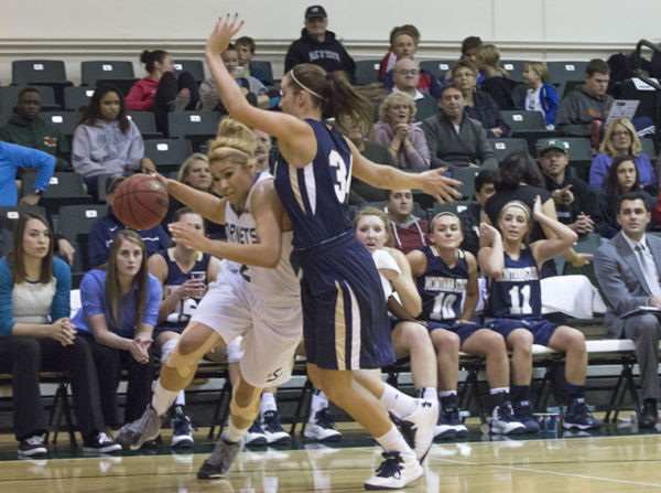 Junior forward Shanti Smith pushes through the Bobcats defense in the 107-95 win at The Nest.