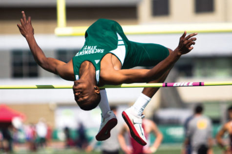 Sacramento State's Londeen McCovery attempts a high-jump during a meet in Hornet Stadium.