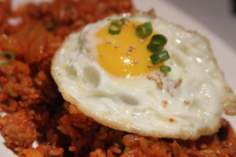 Kimchee grid rice comes topped with a sunny-side up fried egg, allowing the runny yolk and the perfectly cooked egg white to act as a sauce and enhance the flavors of the rice. We all grunt our approval.