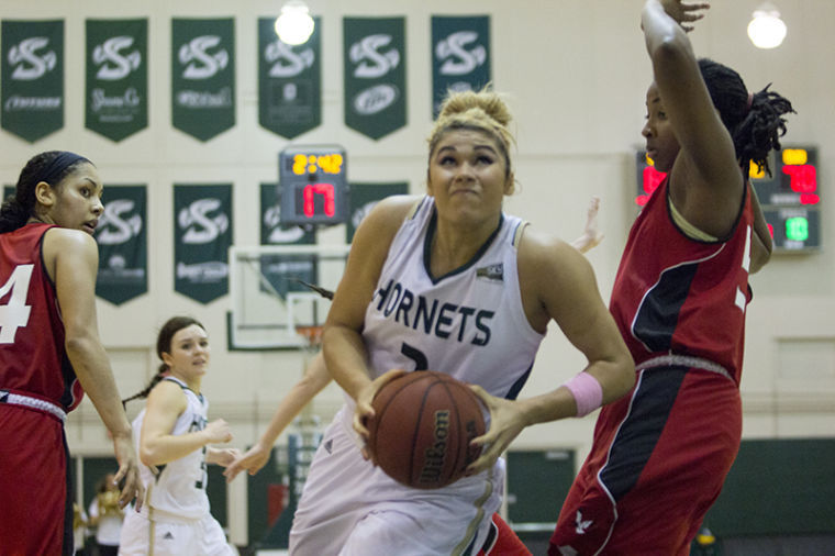 Junior forward Shanti Smith goes up for a lay-up during a game in The Nest.