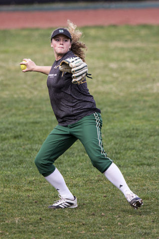 Hornets' outfielder Alexa Chattleton throws the ball back in to the infield.