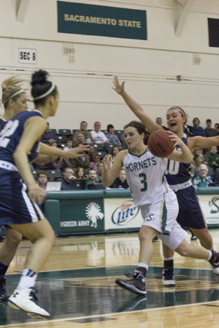 Freshman guard Gigi Hascheff drives into the key during a game in The Nest.