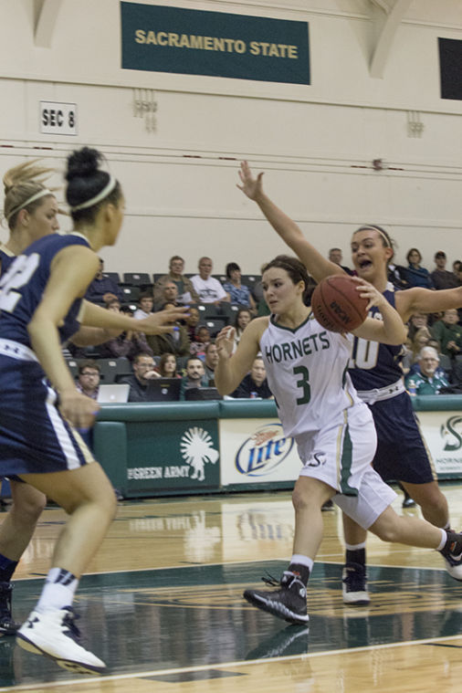 Freshman+guard+Gigi+Hascheff+drives+into+the+key+during+a+game+in+The+Nest.%C2%A0
