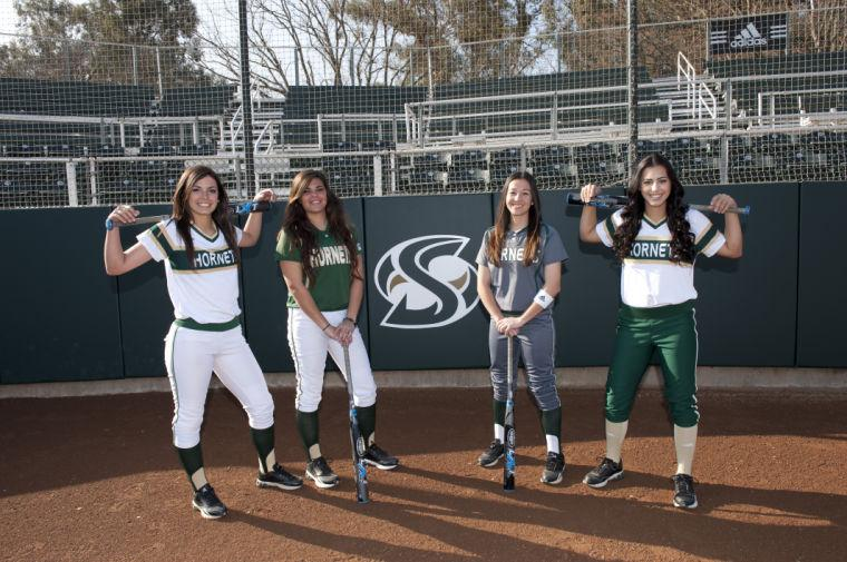 Sacramento State softball players Nicole Clark, Paige Castro, Yesenia Alcala and Paris Prado model new women's uniforms by Adidas.