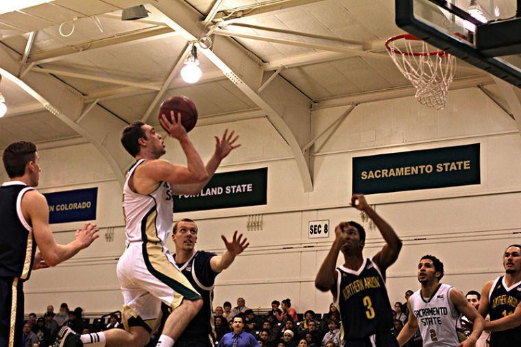 Hornet guard Dylan Garrity pulls up for a jump shot against Northern Arizona on Thursday.