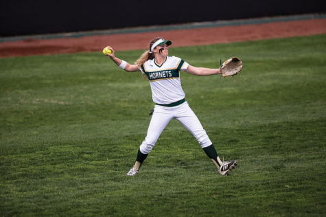 Alexa Chattleton returns a single to the infield to stop the play during the Hornets' match against U.C. Davis.