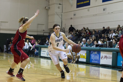 Freshman guard Gigi Hascheff dribbles past the defender.