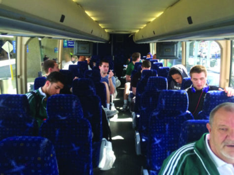 Hornet basketball players prepare for a bus ride to Ogden, Utah.