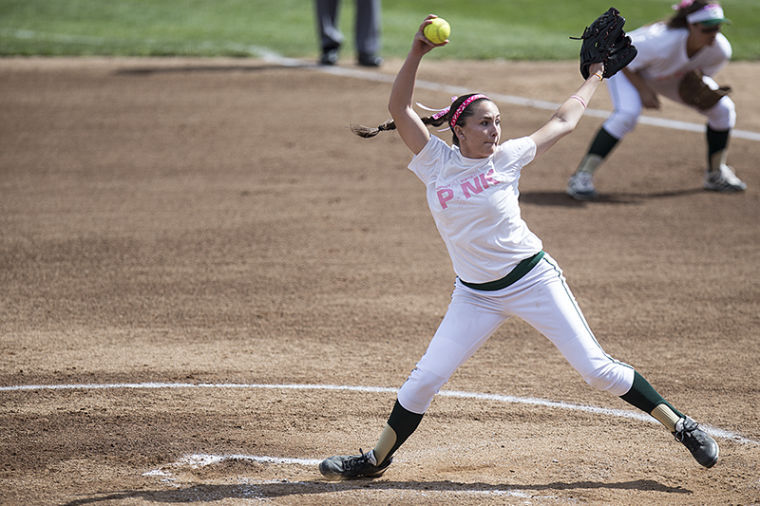Jennifer Hartman winds up for a pitch during Breast Cancer Awareness Day at Sac State.