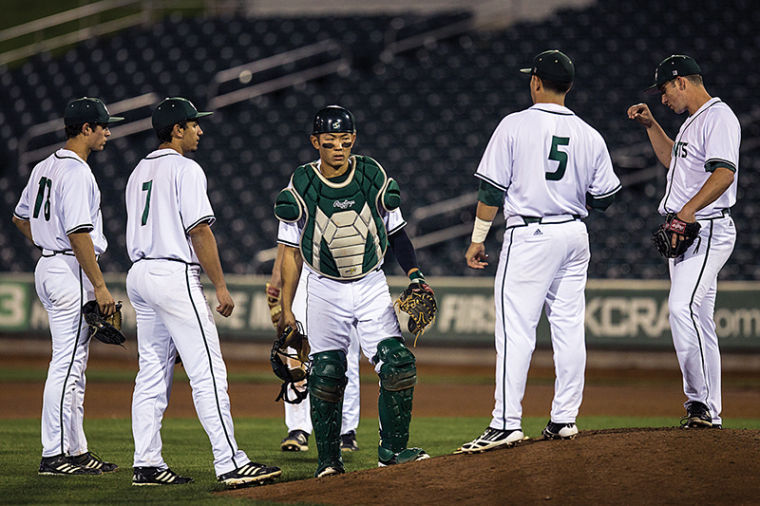 Members of the Hornet baseball team visit the mound midway through their match against University of Nevada on Feb. 25 at Raley Field.