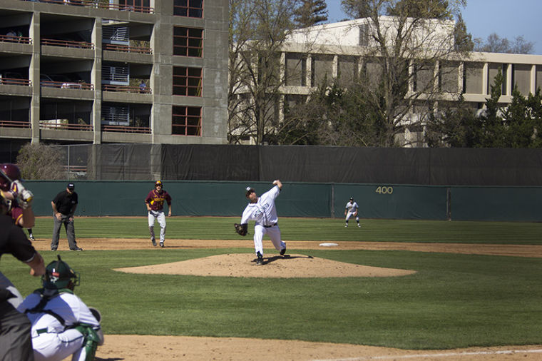 Starting pitcher Sam Long delivers the pitch to a University of Minnesota batter, Saturday at John Smith Field.