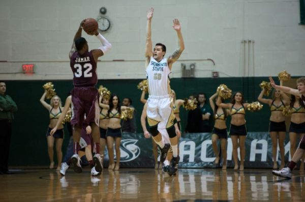 Junior forward Zach Mills goes up to block Montana's Kareem Jamar's jump shot in the 70-55 loss to the Grizzlies.
