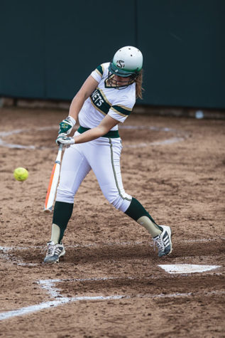 Hornet Sasha Margulies hits the ball to center field into the glove of the Aggie's defense.