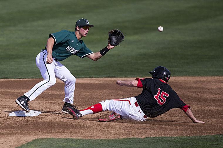 Brandon Hunley tags out University of Utah's Cory Hunt at second base.