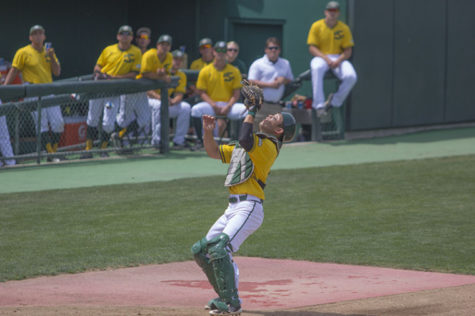 Catcher Dane Fujinaka tracks down the foul ball for an out in the top of the fourth inning.