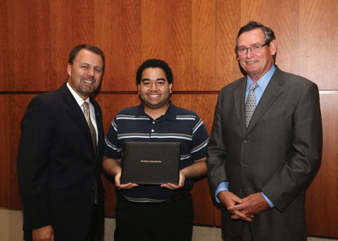 Sac State student Patrick Landrum recieved the CSU Trustee's Award for Outstanding Achievement. Landrum poses for a picture with CSU Board of Trustees' Chair Lou Monville and CSU Chancellor Timothy P. White