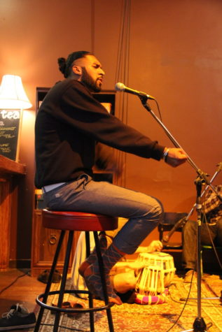 Salvin Chalal performs using clever wordplay on July 25, at the Heartwood Community Cafe in Vancouver, Canada.