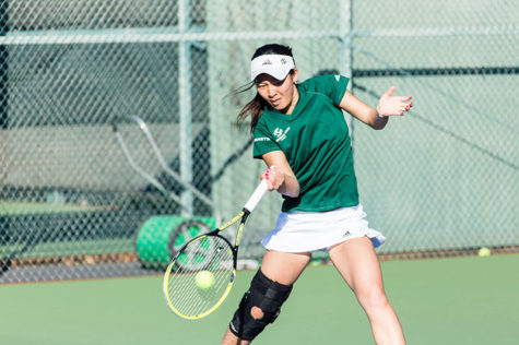 Sacramento State tennis player Jennifer Ong returns a serve during a doubles match against UC Davis on Friday, Jan. 30, 2015.
