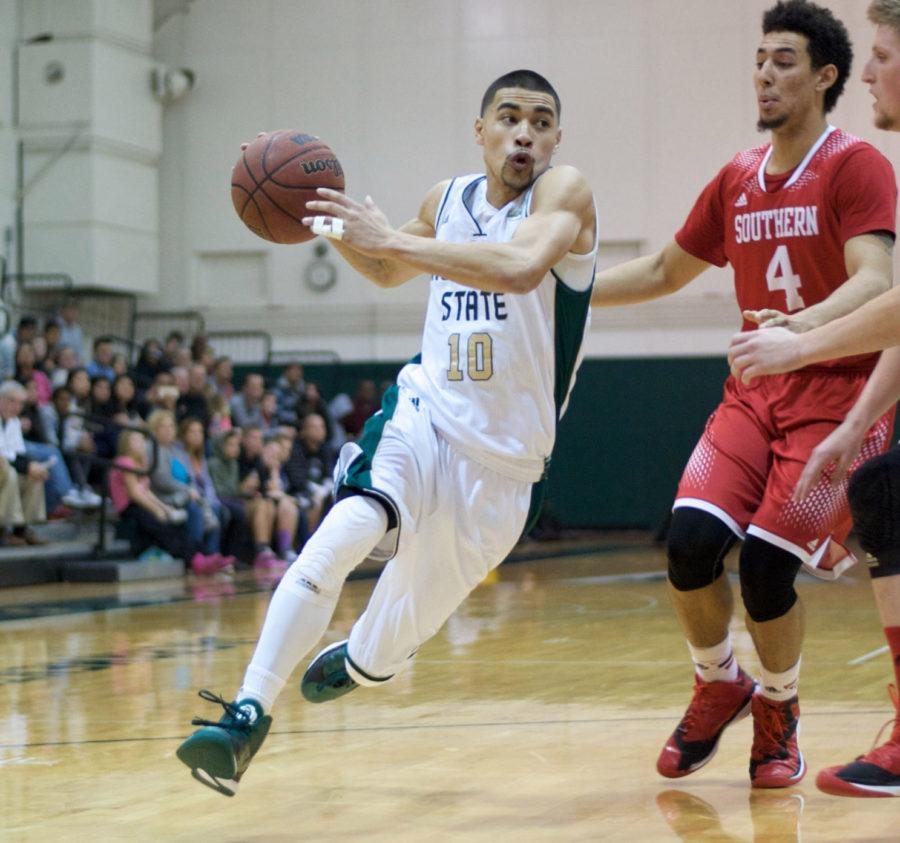 Senior guard Mikh McKinney powers past Trey Kennedy of Southern Utah at the Hornets' Nest on Saturday, Jan. 3, 2015. McKinney scored a game-high 21 points in a 90-75 victory over the Thunderbirds.
