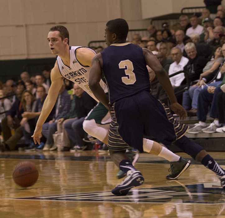 Senior guard Dylan Garrity of Sacramento State cuts past Montana State guard Michael Dison as he looks for an open teammate to make a pass to during a men's basketball game in the Hornets' Nest on Thursday Jan. 29, 2015. Garrity broke Sac State's all time record of career assists, ending the game with a new record of 504.