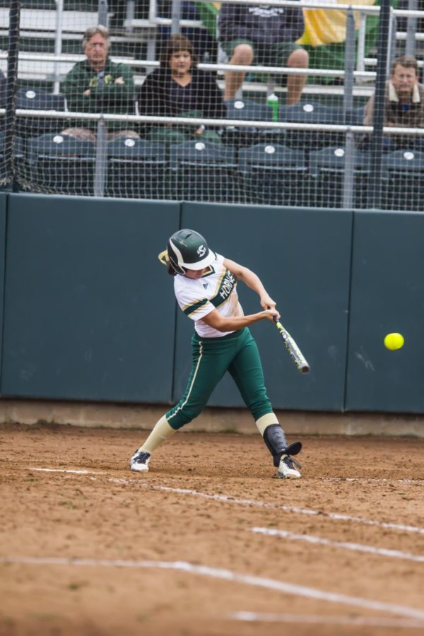 Senior short stop , Paige Castro, bats during a double header against St. Mary's on Saturday, Feb. 21, 2015 at Shea Stadium. The Hornets went on to lose both of their games.