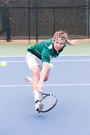 Sac State senior Tom Miller sprints towards the left corner of the court to backhand a ball during his singles match against Pacific on Saturday, Feb. 21, 2015. Miller lost his match against Pacific freshman Bernardo Oliveira.