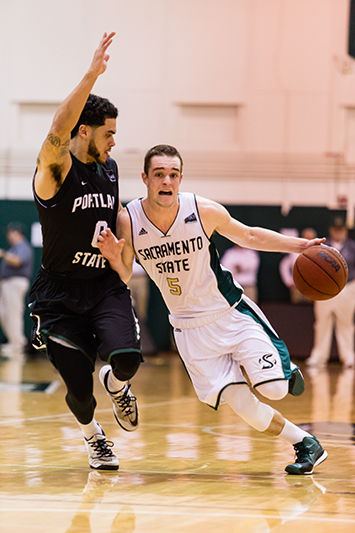 Sacramento State senior Dylan Garrity drives past Portland State senior Gary Winston during the second half of the basketball game between Sac State and Portland State on Saturday, Feb. 7, 2015. Garrity scored 16 points in Saturday's game.