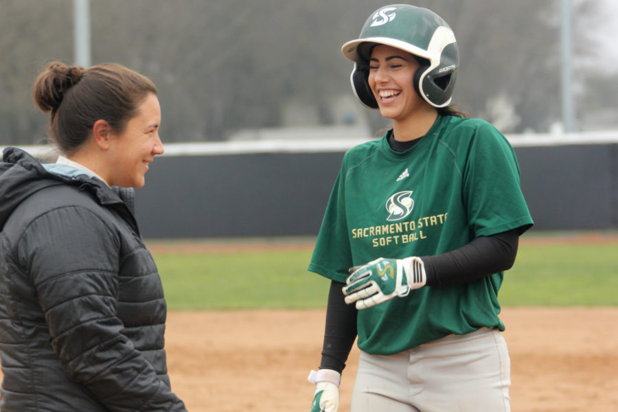 Senior Paris Prado jokes with coach Danielle Kaminaka while running bases during a practice on Thursday Jan. 22, 2015. Prado was granted another year of eligibility after she was cut from the softball team her freshman year.