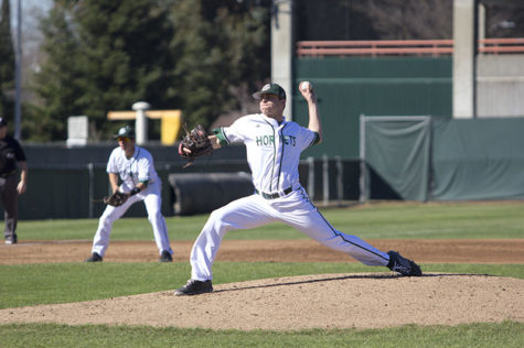 Sacramento State baseball's sophomore pitcher Sam Long made the start in Saturday's game against Utah on Feb. 14, 2015 at John Smith Field. Long threw an impressive outing totaling five innings with no earned runs. Third baseman Brandon Hunley sits in ready position.