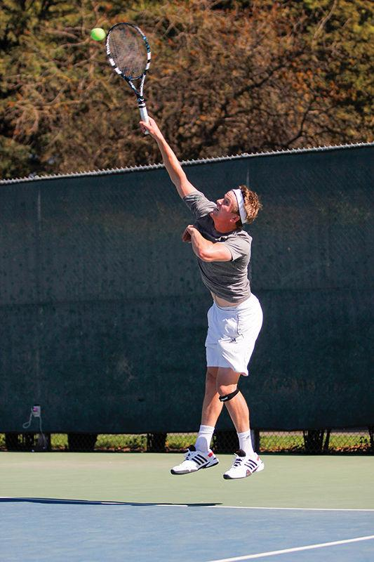 Tom Miller of Sacramento State men's tennis serves against University of Northern Colorado at California State University, Sacramento on Wednesday, March 18, 2015.