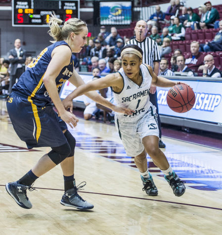 Senior Fantasia Hilliard pushes past an University of Northern Colorado player as she heads to the basket in the semifinal of the Big Sky Conference Tournament on March 13, 2015 in Missoula, Montana. The Hornets went on to lose the game 81-79 in overtime.