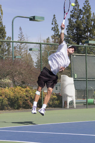 Senior Roy Brandys serves the ball to the opposing court during doubles on Sunday, March 8, 2015 at Rio Del Oro Racquet Club against Southern Utah University. Brandys and Sean Kolar went on to win their match.