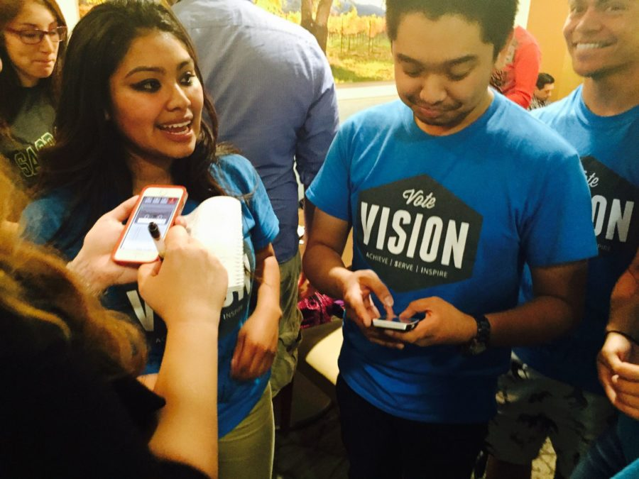 Yajayra Gonzalez, left, talks with other members under the Vision slogan after she was elected president for Associated Students, Inc. All candidate positions will be effective for the 2015-2016 academic year.
