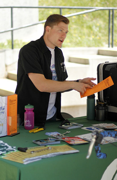 Peak Adventures bike shop manager Rad Beauton describes the services offed at the Peak Adventures bike shop during Bike to Sac State Day on Wednesday, May 6, 2015 at the Plaza near the Guy West Bridge.