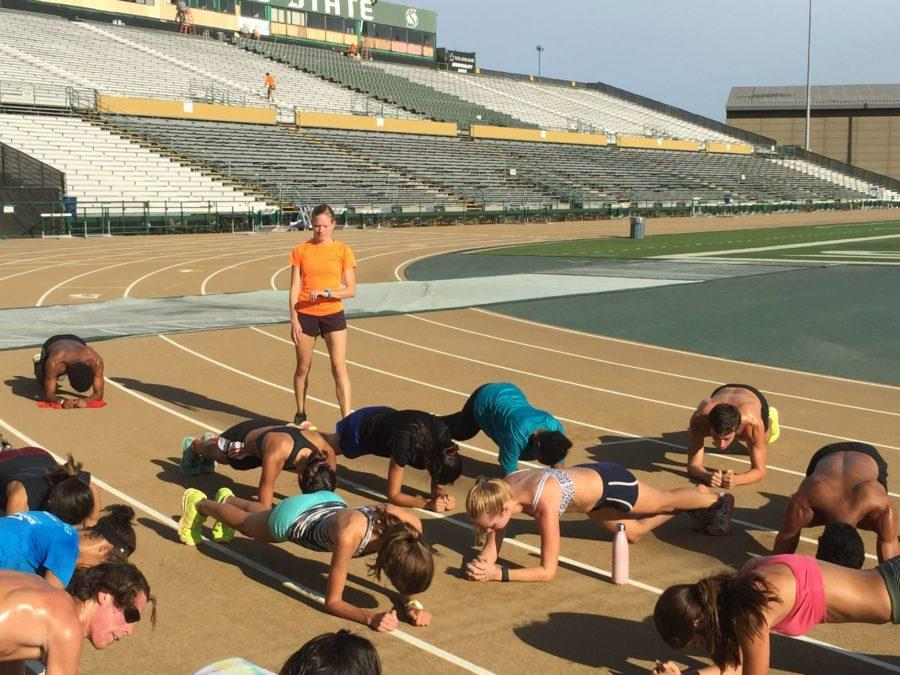 Cross+country+coach+Laura+Harmon+watches+her+runners+as+they+stretch+out+following+practice+Friday%2C+Aug.+28%2C+2015+at+Hornet+Stadium.