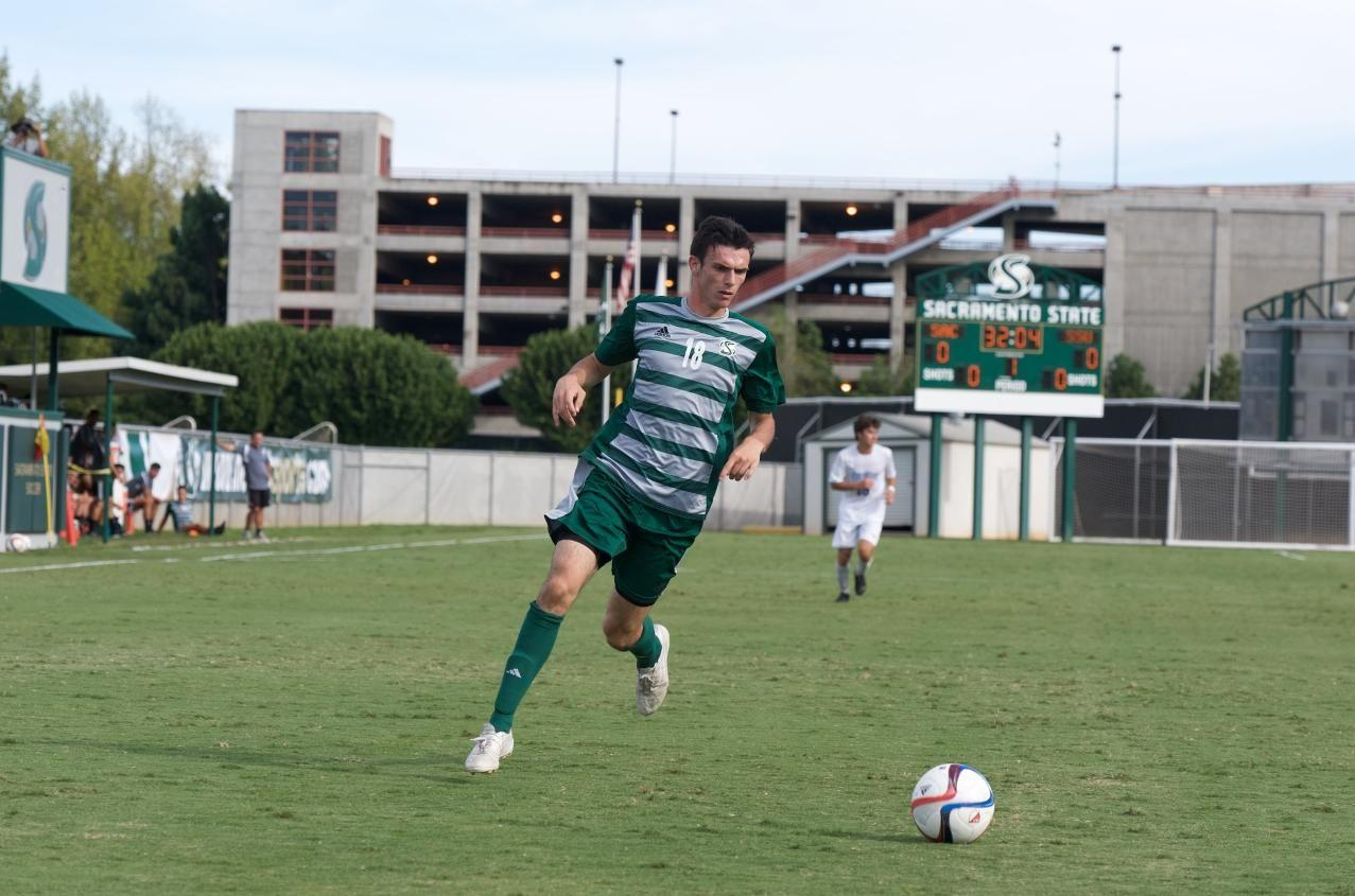 Sacramento State forward Brad Bumgarner runs with the ball during an exhibition match on Sunday, Aug. 23 at Hornet Soccer Field. It was the second of two exhibition matches played at Sac State before the season began.