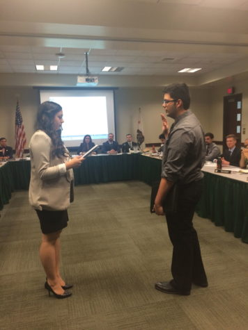 Melissa Bardo, ASI President, swears Abraham Mendoza III to the office of Director of Health and Human Services at the September 2 working board meeting in the Orchard Suite of the University Union.