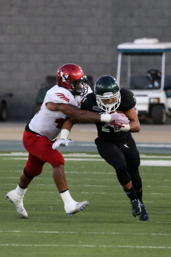 Sacramento State running back Jordan Robinson makes contact with an Eastern Washington defender during the game on Saturday, Sept. 26, 2015 at Hornet Stadium. Robinson ended the night with 104 rushing yards.