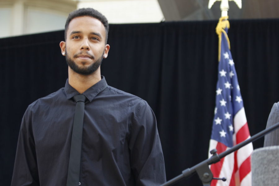 Anthony Sadler, a senior at Sacramento State, listens to Sacramento Mayor Kevin Johnson's speech about the events in France on August 26.
