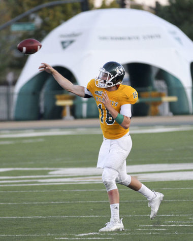 Quaterback Daniel Kniffen drops back to pass the ball to a receiver on Saturday, Sept. 5, 2015 against Eastern Oregon. Kniffen was 22-for-34 with 282 yards and two touchdowns on the night leading the Hornets to a 41-20 victory over the Mountaineers.