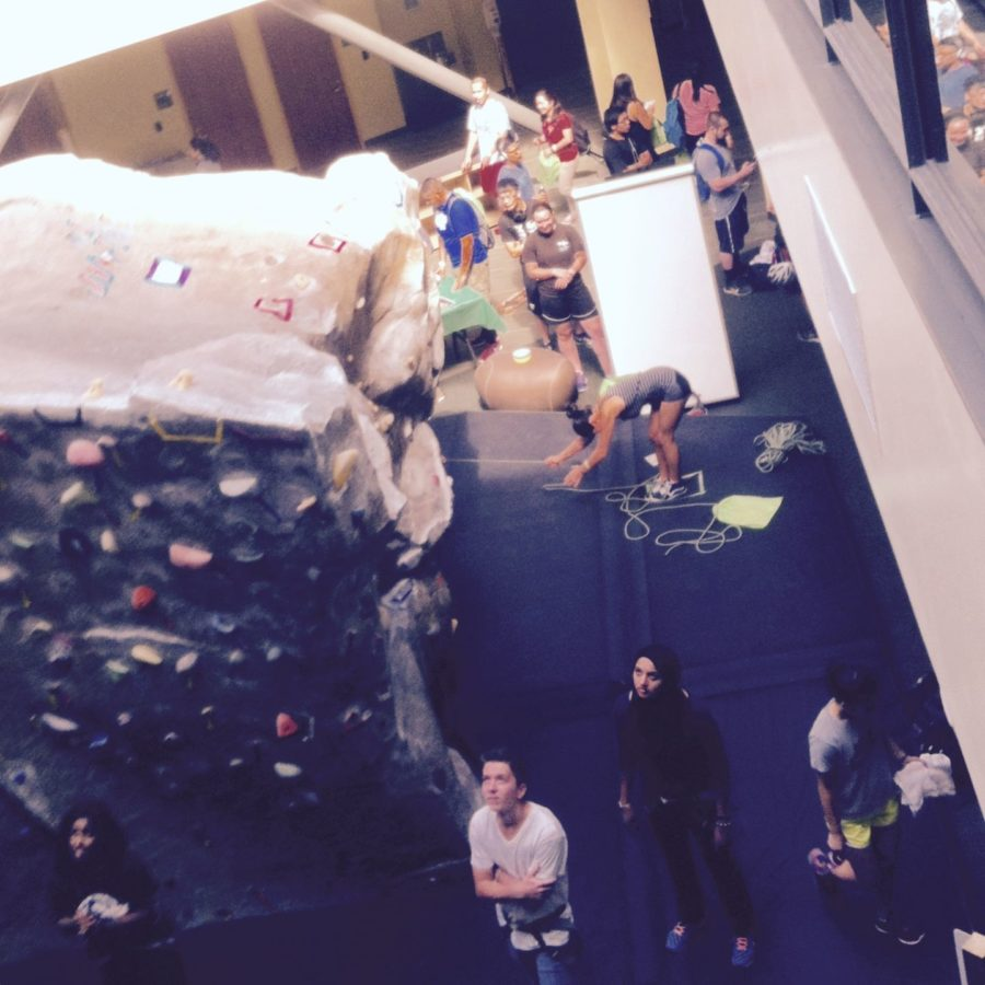 Students prepare to climb the rock wall located inside the WELL during WELLcome Back event.
