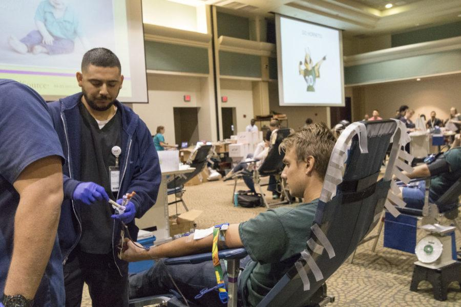 Eric Muller, sophomore, has blood sample taken at the University Union, Oct. 20, 2015.