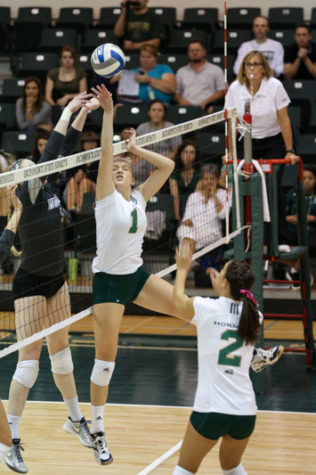 Setter Kennedy Kurtz attempts to tip a pass over the net. Kurtz led the Hornets with 35 assists against Montana on Saturday, Oct. 24, 2015 at the Hornets Nest.