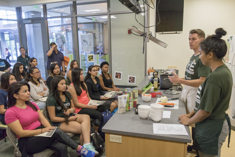 Students listen to Scott Brown and Janice Garcia talk about nutrition, diet and how to cook. The Well, The Cove, Oct. 15, 2015