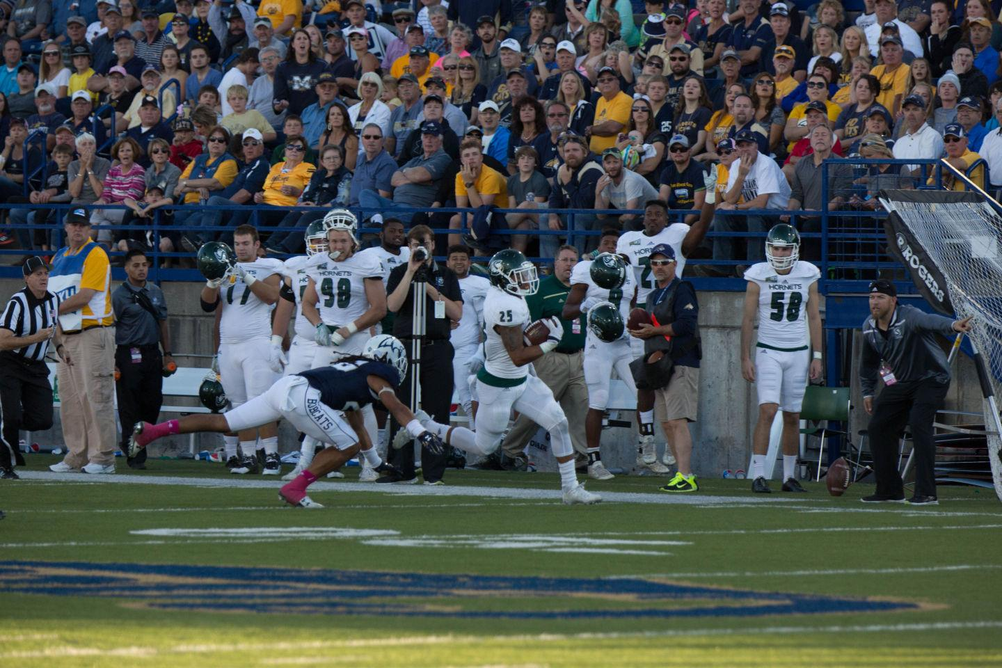 Hornets' running back Jordan Robinson runs the ball downfield against Montana State on Saturday, Oct. 10, 2015 at Bobcat Stadium. Robinson ran for 108 yards on 17 carries in the game.